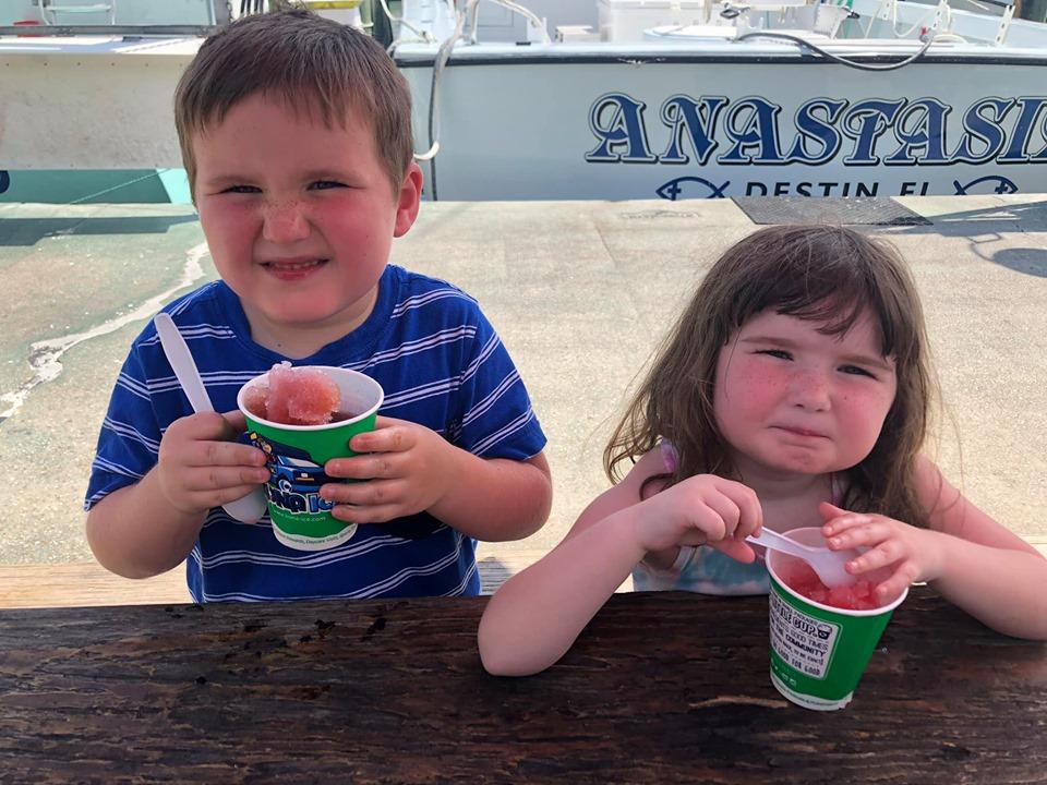 Kids eating snow cones at the Destin Harbor Boardwalk in Destin.   Destin, Florida with the Kids