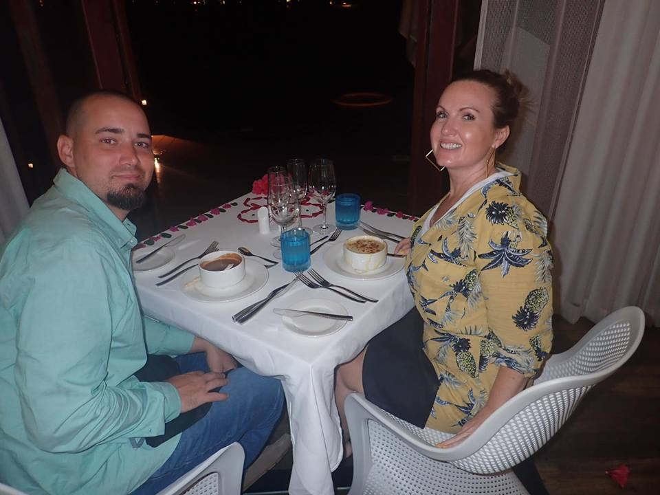 Couple having dinner in the Bungalow in Jamaica.   Jamaica Over-Water-Bungalows