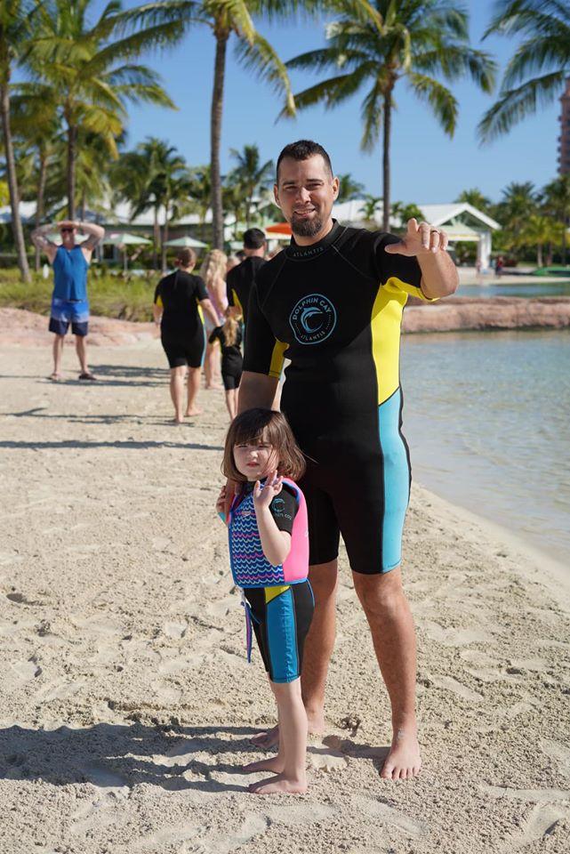 Dad with his little girl at the Dip N Discover at Dolphin Cay at the Atlantis resort.   Atlantis, Bahamas