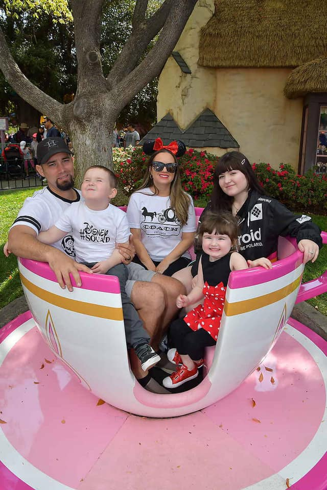 Family posing in tea cup ride at Disneyland.   Disneyland Resort Hotels, Anaheim; What you need to know.