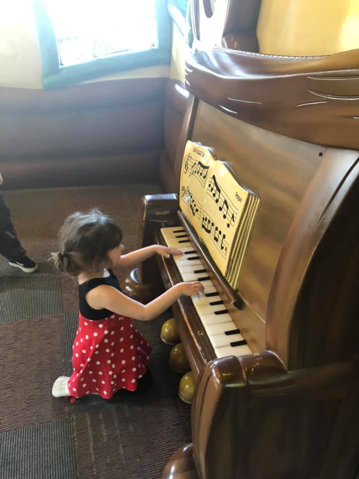 Little girl playing giant piano in Goofy's Fun House at Disneyland.   Disneyland Resort Hotels, Anaheim; What you need to know.