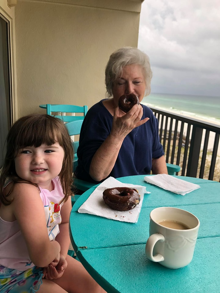 People eating donuts on the patio from Donut Hole Bakery Cafe in Destin.   Destin, Florida with the Kids