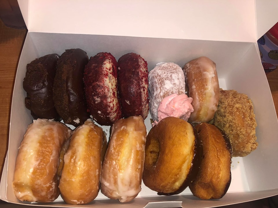Box of donuts from Donut Hole Bakery Cafe in Destin.   Destin, Florida with the Kids