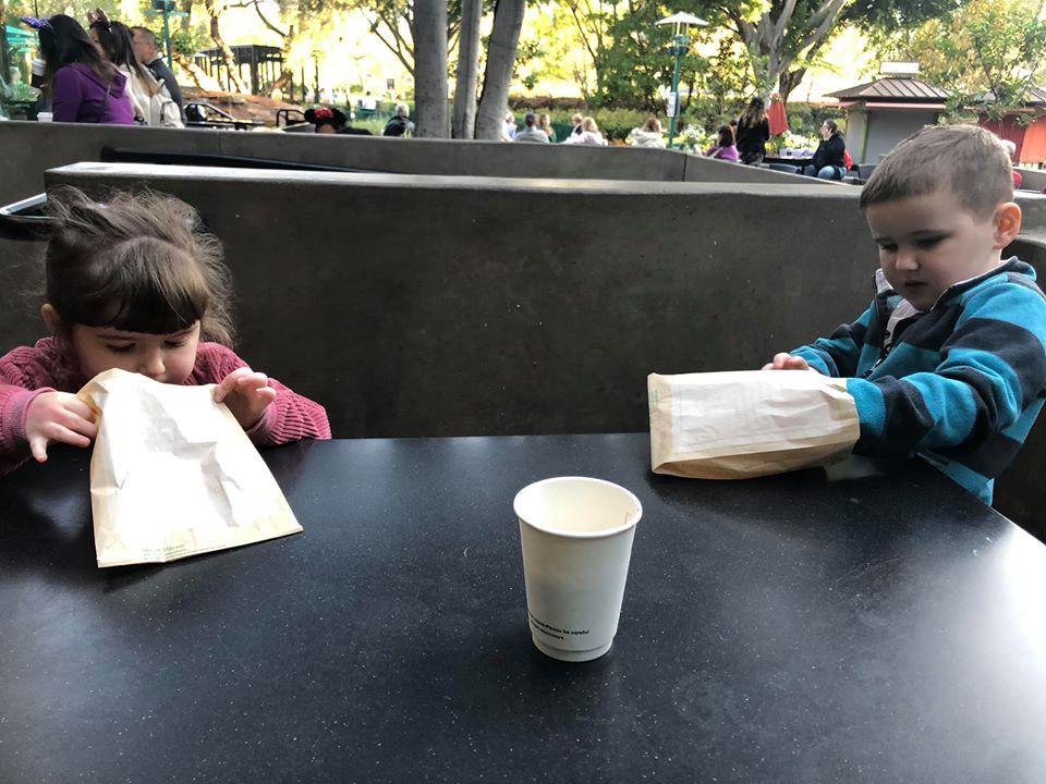 Kids eating snacks at Starbucks in Downtown Disney at Disneyland.   Disneyland Resort Hotels, Anaheim; What you need to know.