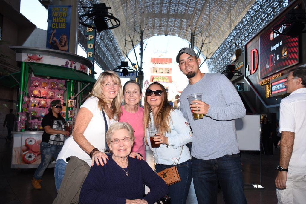 Group of people posing on Vegas strip, drinking. | Las Vegas- A Guide to Vegas