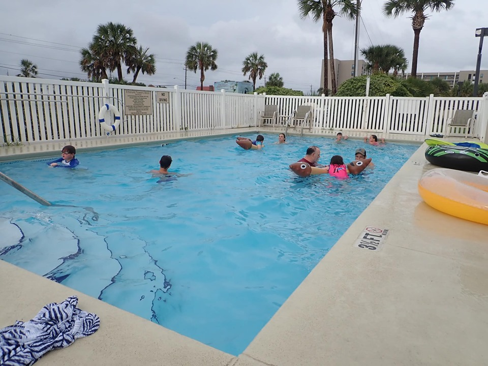 Pool with people swimming at the Emerald Coast beach in Destin.   Destin, Florida with the Kids