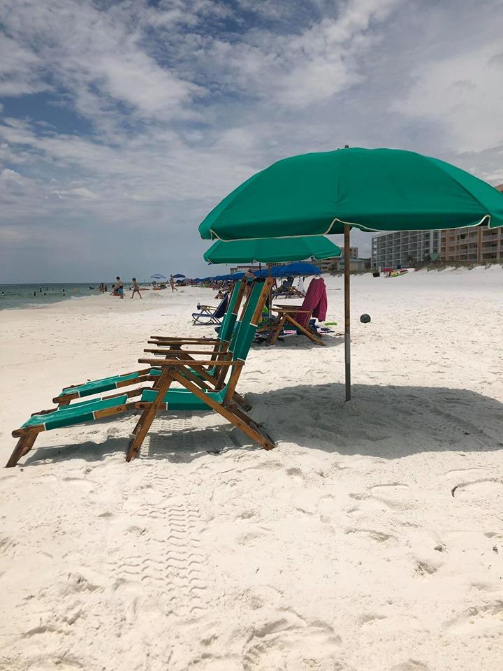 Beach chairs on Emerald Coast beach in Destin.   Destin, Florida with the Kids