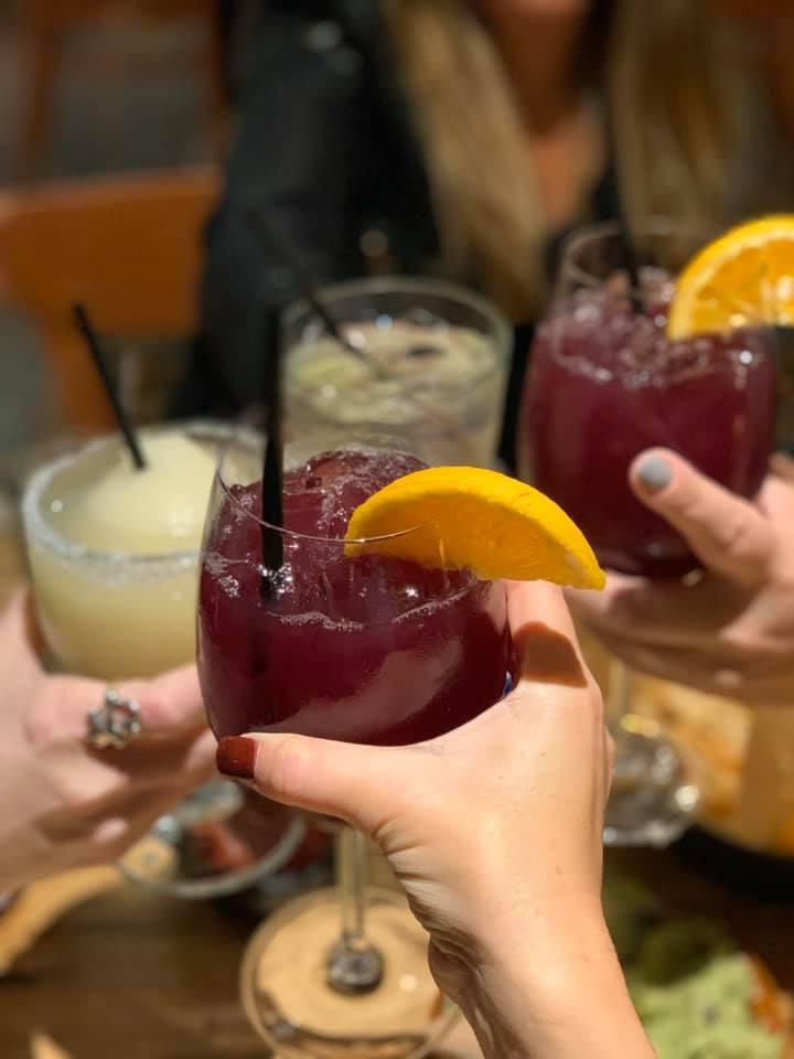 Women toasting their cocktails at Escalante's Fine Tex-Mex.   Girls Weekend Getaway- Woodlands, TX
