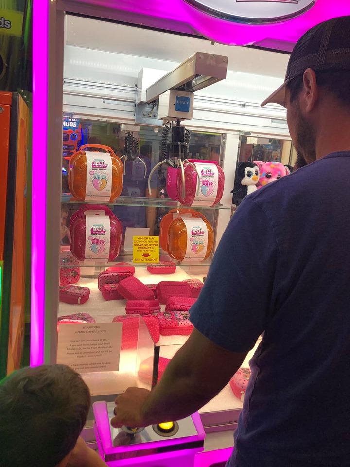 Man playing games at Fat Daddies arcade in Destin.   Destin, Florida with the Kids