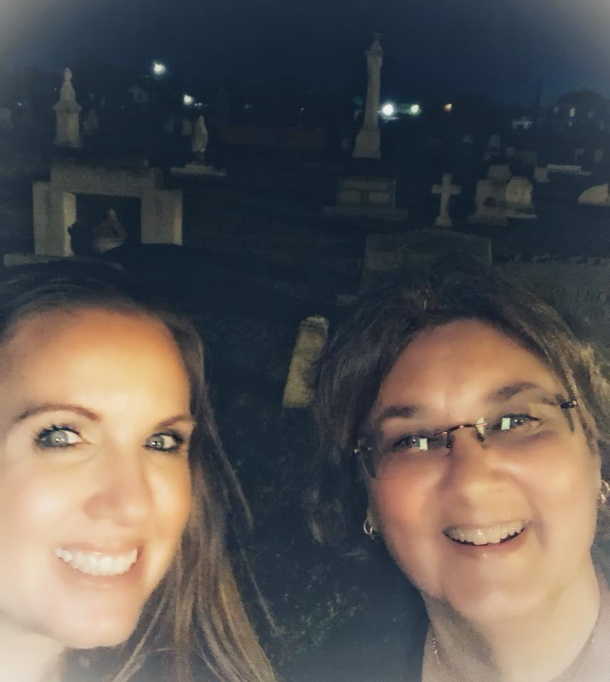 """Two women taking a selfie at night during the Galveston Graveyard Tour in Galveston.   Adult Weekend in Galveston, Texas; on """"The Strand"""""""