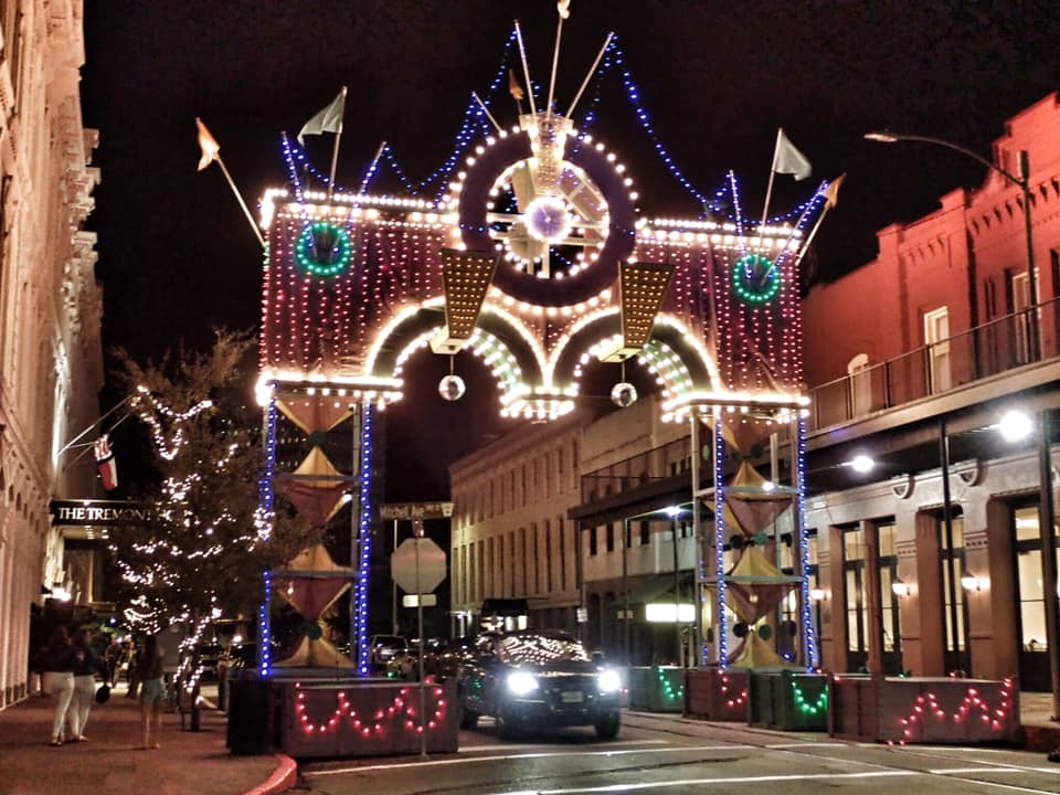 """Downtown streets at night in Galveston.   Adult Weekend in Galveston, Texas; on """"The Strand"""""""