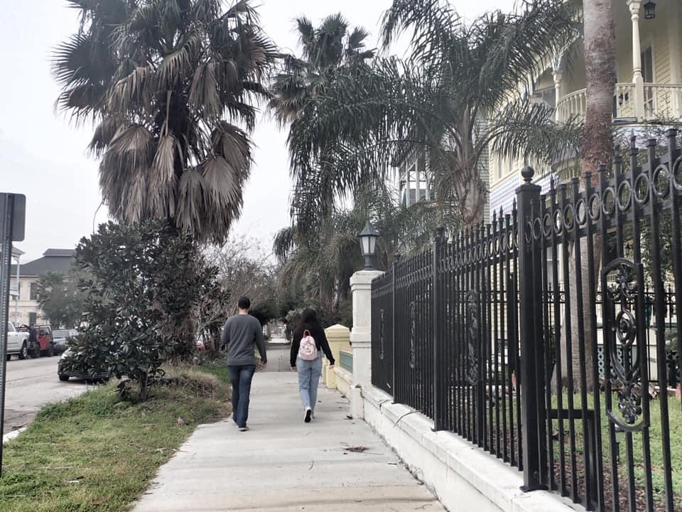 "People walking down the sidewalk in Galveston.   Adult Weekend in Galveston, Texas; on ""The Strand"""