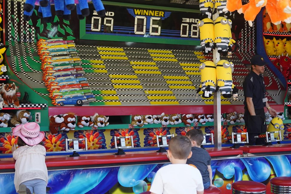 Kids playing games at the fair. | State Fair of Texas-Dallas