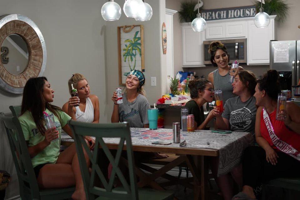 Group of women inside townhouse at Corpus Christi.   Corpus Christi Bachelorette Weekend