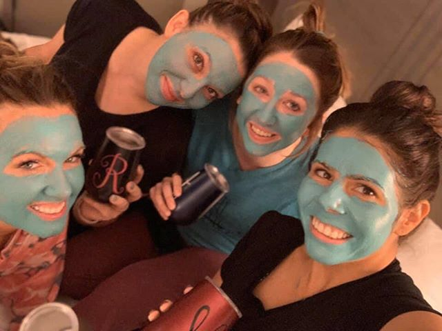 Group of girls with face masks on and holding drinks.   Girls Weekend Getaway- Woodlands, TX