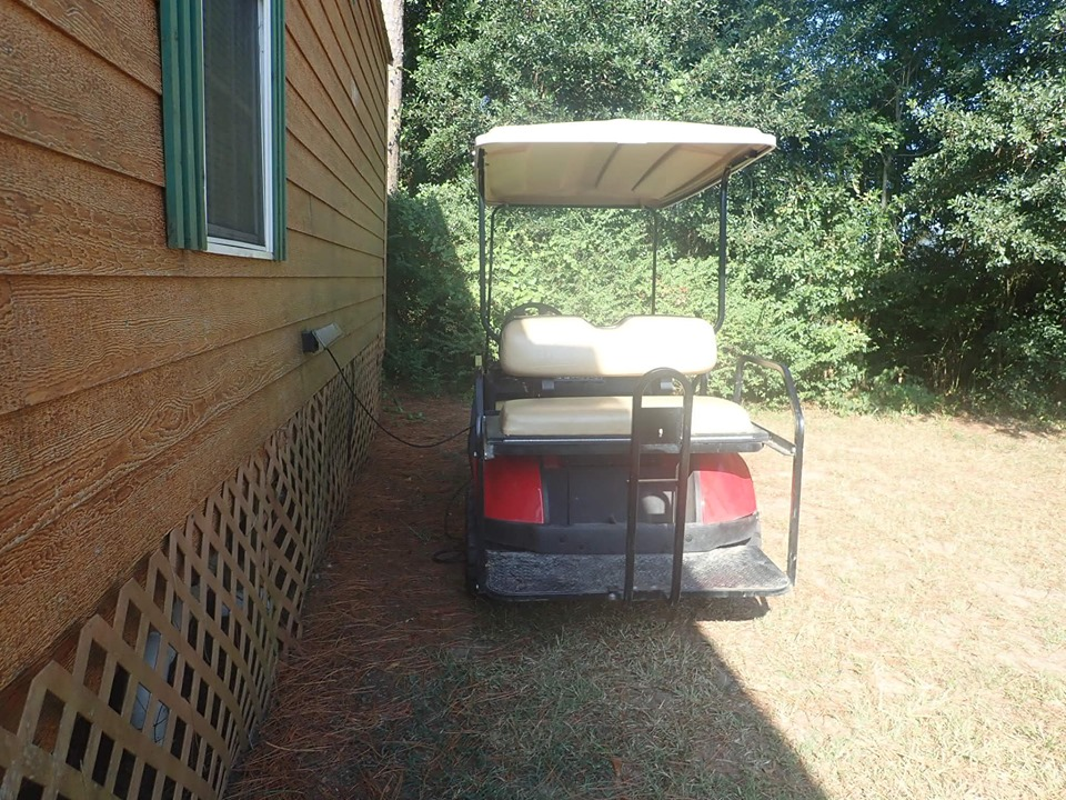 Golf cart charging at Jellystone in Texas.   Jellystone Park in Waller, Texas