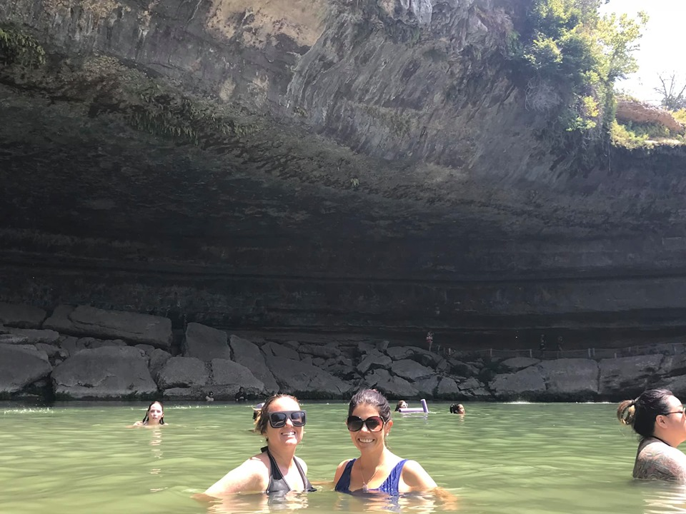 Two women swimming in Hamilton Pool in Austin.  Weekend Guide to Austin, Texas