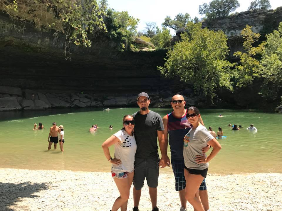 Two couples posing in front of Hamilton Pool in Austin.  Weekend Guide to Austin, Texas