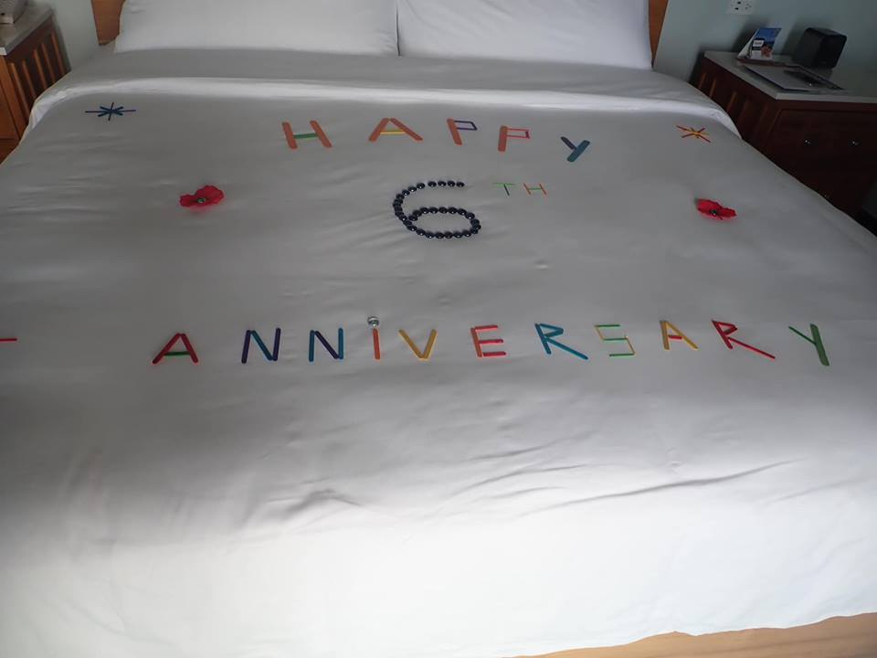Happy Anniversary sign on bed at Sandals resort in Jamaica.   Jamaica Over-Water-Bungalows