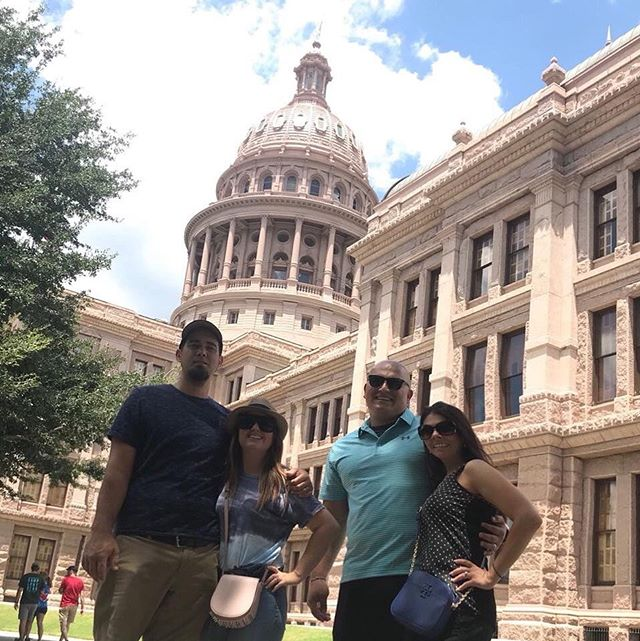 Two couples posing in front of historic buildings in Austin.  Weekend Guide to Austin, Texas