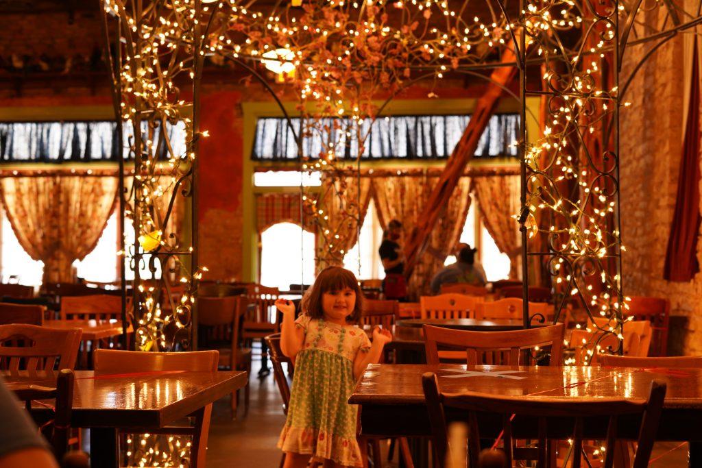 Little girl inside Babe's Chicken restaurant.   A Guide to Granbury, Texas