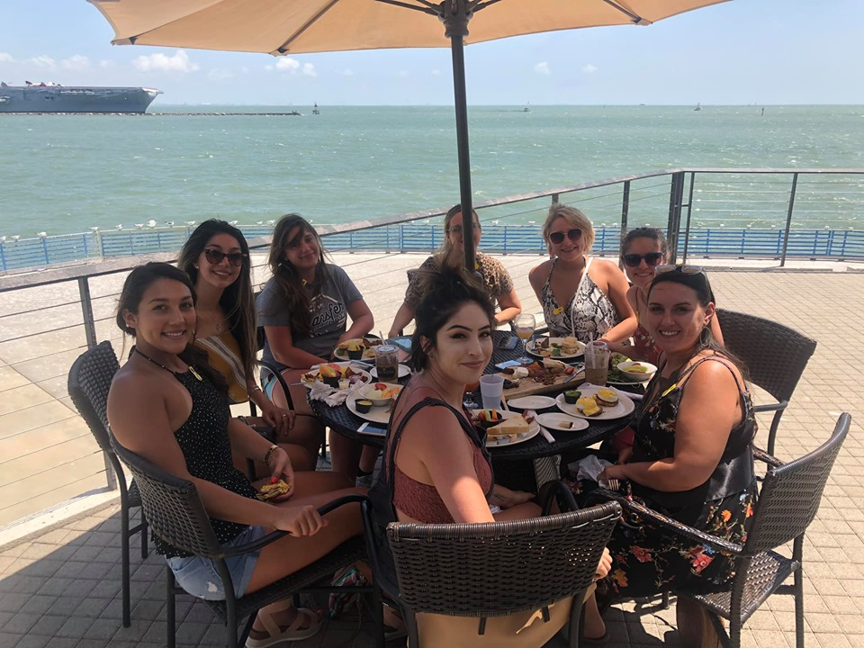 Women eating lunch outside at Hester's Cafe in the Art Museum in Corpus Christi.   Corpus Christi Bachelorette Weekend