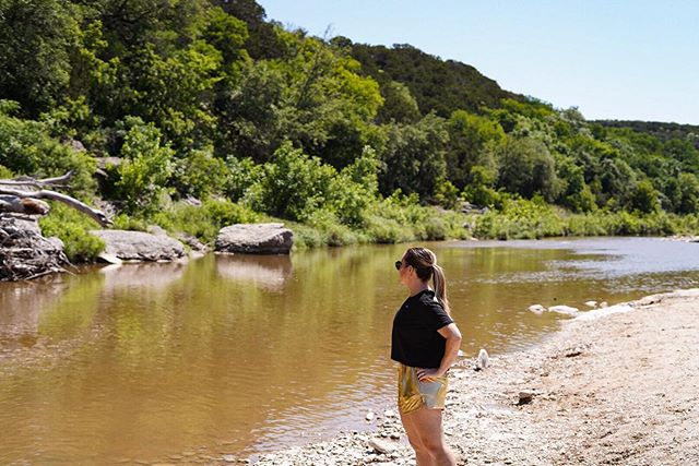 Woman standing at the end of the creek bed.   Dinosaur Valley State Park in Texas