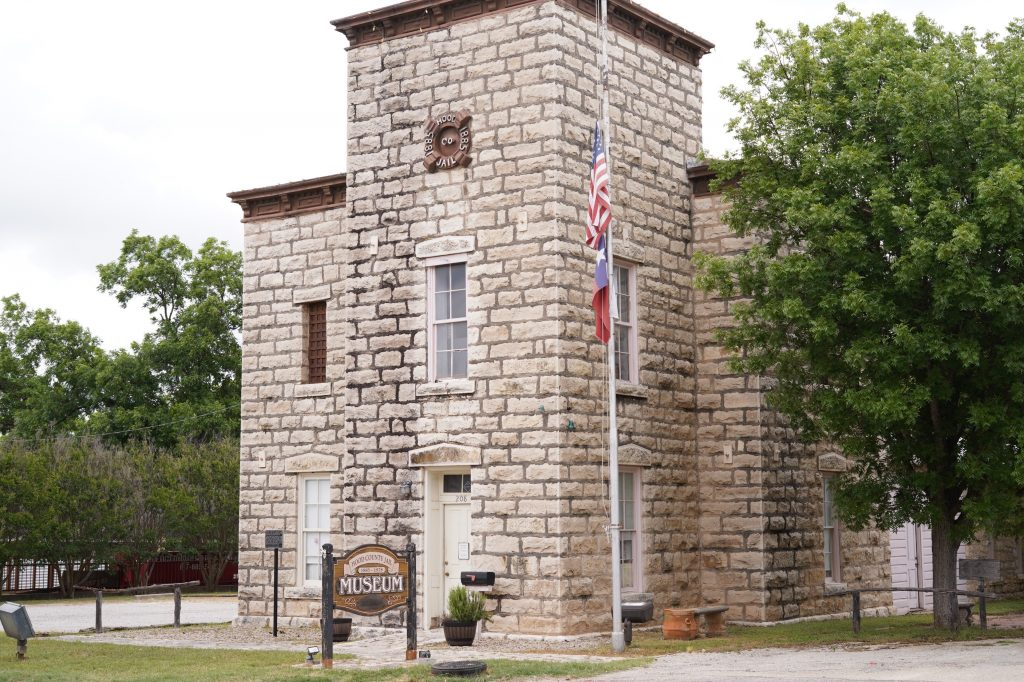 Outside the Hood County Jail Museum.   A Guide to Granbury, Texas