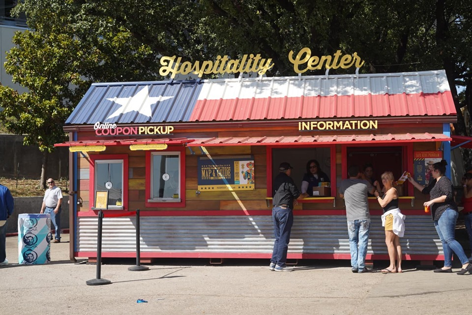 People at the counter window of the Hospitality Center at the fair.| State Fair of Texas-Dallas