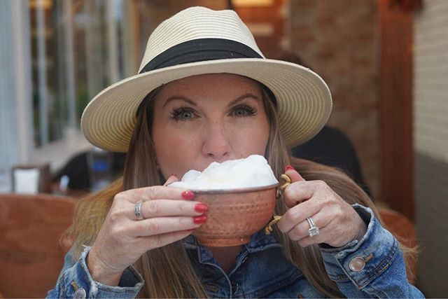 Woman drinking cup of Ayran outside at a restaurant. | Istanbul, Turkey