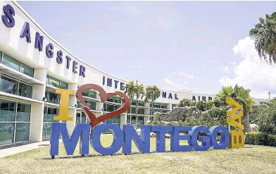 I love Montego Bay sign outside Sangster International Airport in Jamaica. | Jamaica Over-Water-Bungalows