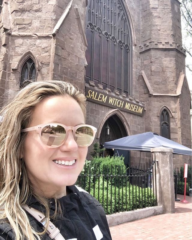 Woman taking a selfie in front of Salem Witch Museum. | What to do in Salem, MA