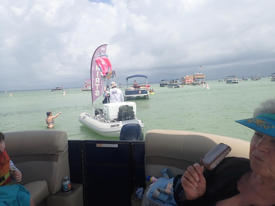 People eating ice cream on the Pontoon at Crab Island in Destin.   Destin, Florida with the Kids