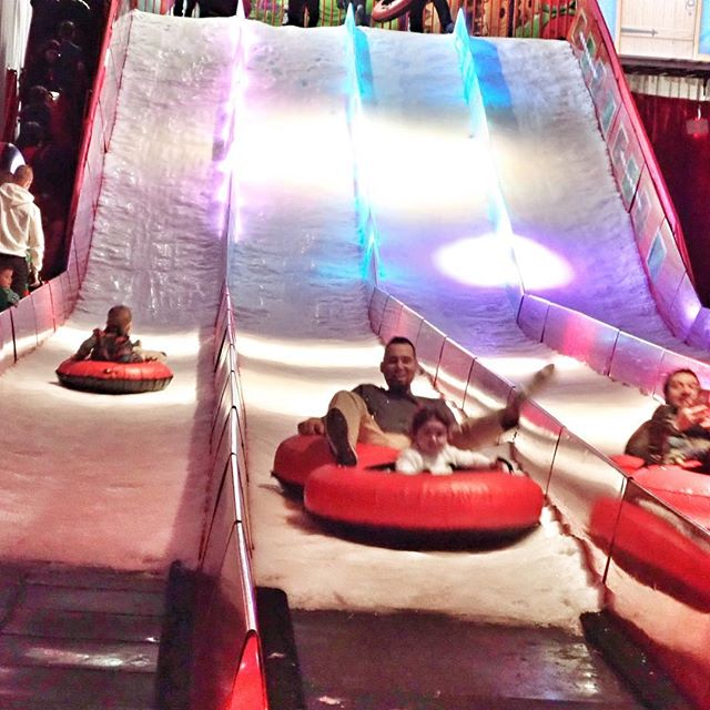 People tubing at the indoor snow tubing area at the Gaylord Texan in Texas. | Christmas at the Gaylord Texan Hotel