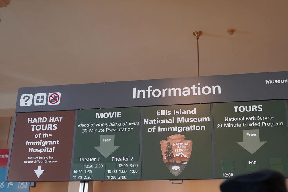 Information desk with sign at Ellis Island.   New York City