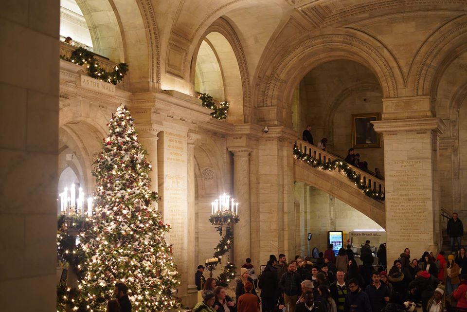 People walking around inside the New York Public Library.   New York City