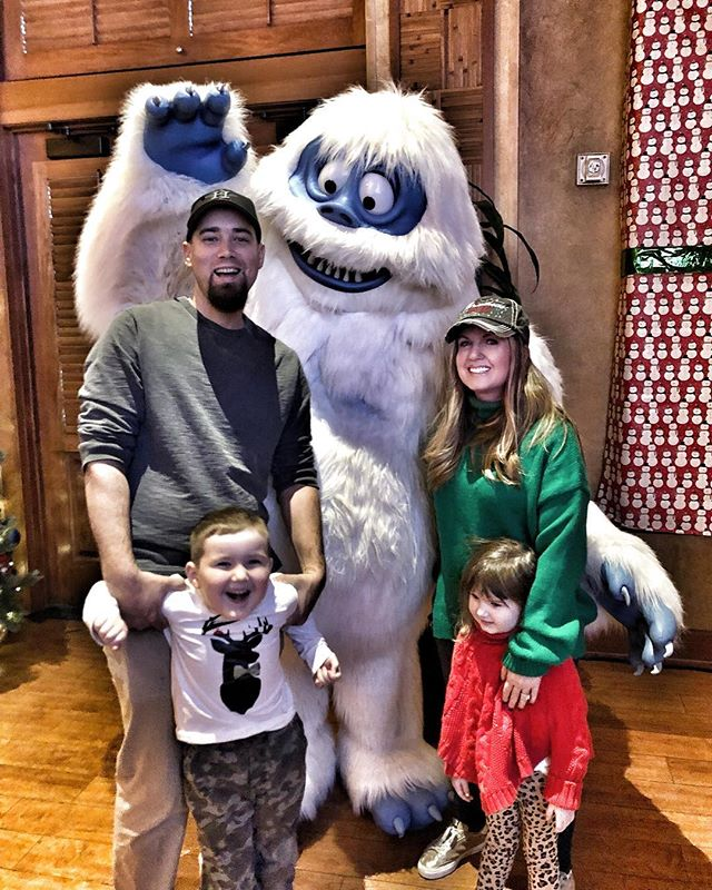 Family posing with character at Breakfast with Rudolph at the Gaylord Texan in Texas. | Christmas at the Gaylord Texan Hotel