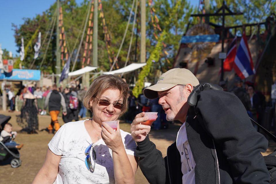 People takin Jello shots outside.| Texas Renaissance Festival
