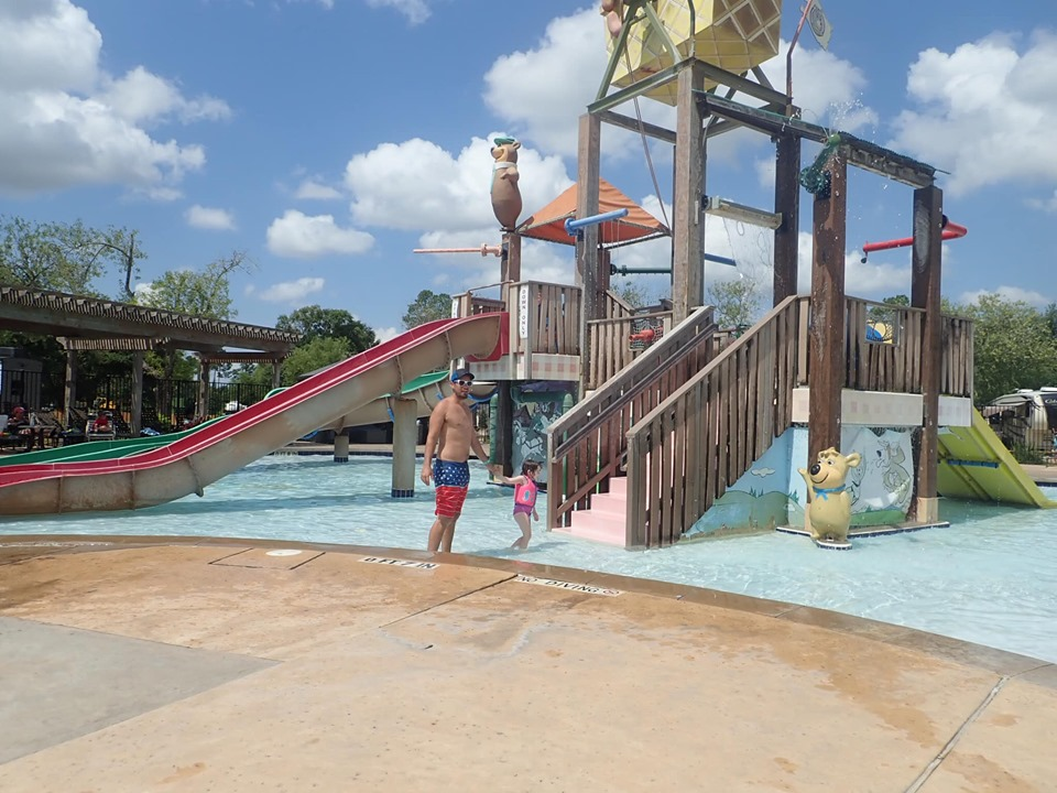 People playing at the waterpark at Jellystone in Texas.   Jellystone Park in Waller, Texas