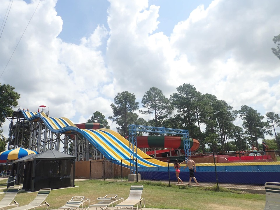 Older kid rides at the waterpark at Jellystone in Texas.   Jellystone Park in Waller, Texas