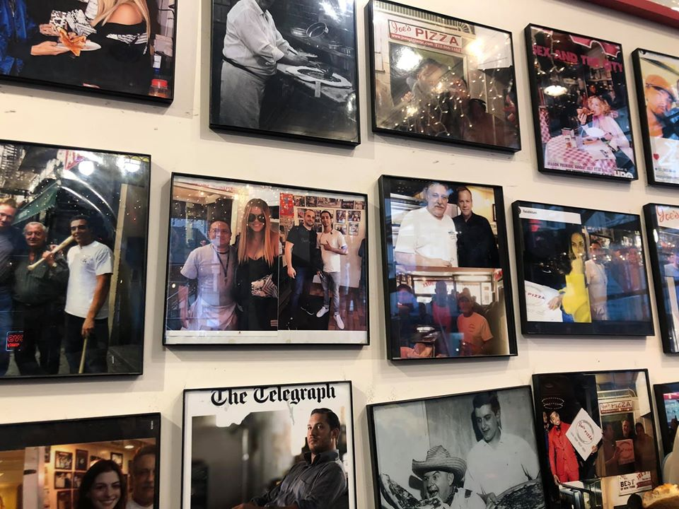 Wall of pictures of celebrities at Joe's Pizza.   New York City