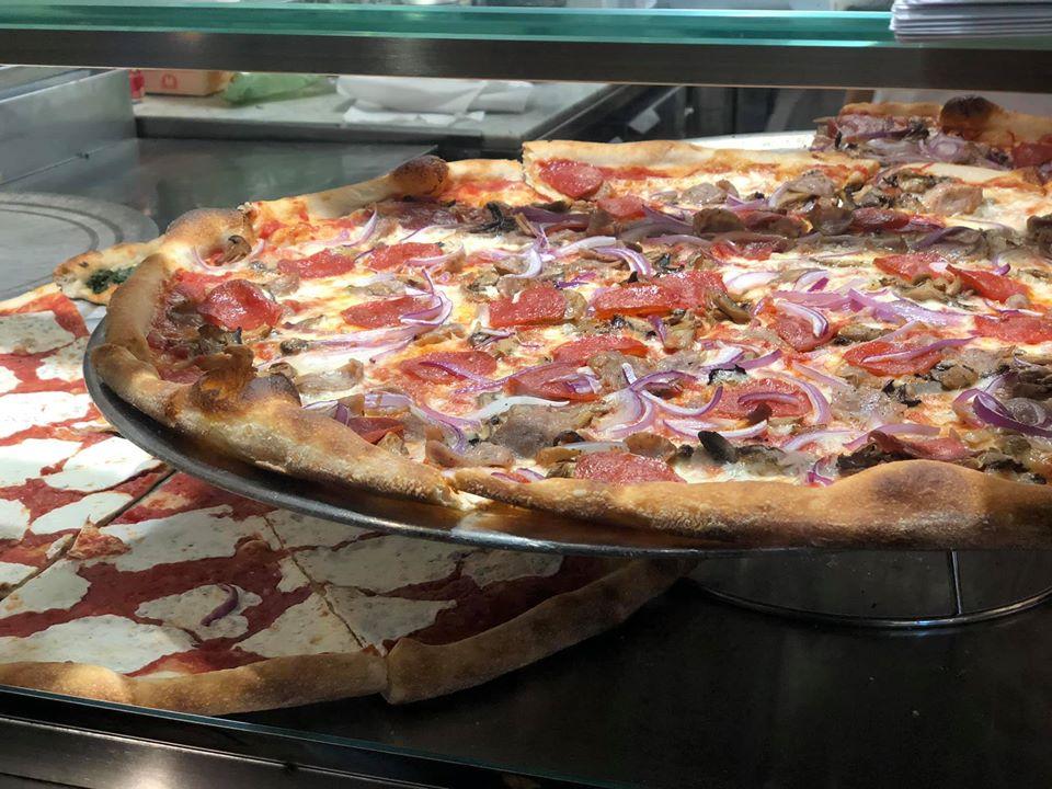 Large pizza on tray at Joe's Pizza.   New York City