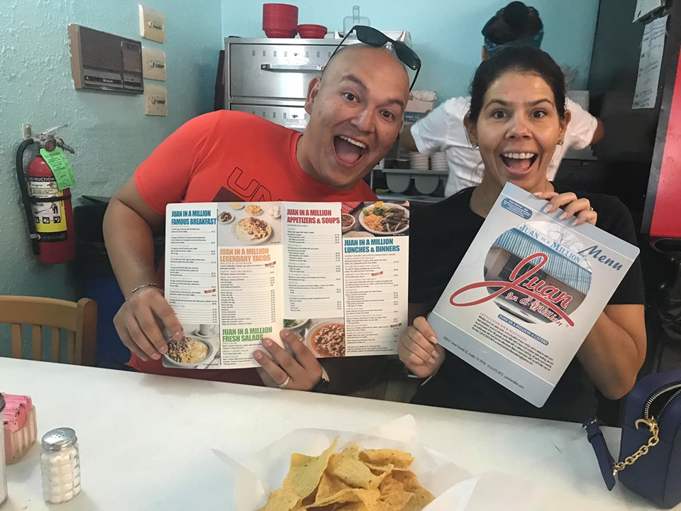 Couple posing with menus at Juan in a Million restaurant in Austin.  Weekend Guide to Austin, Texas