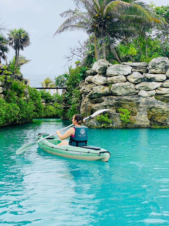 Woman kayaking in the water at Xcarte.   Guide to Hotel Xcaret in Mexico