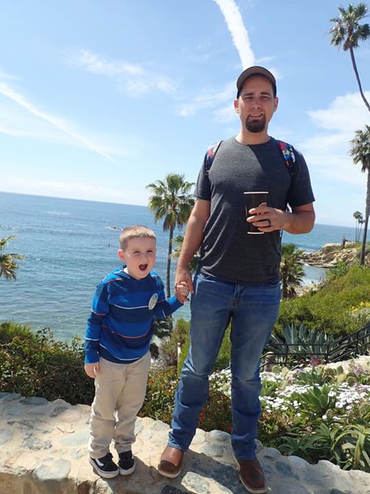 Dad and his young son posing on Laguna Beach.| 24 Hours in Orange County, CA