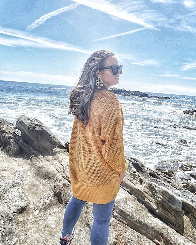 Women posing on the rocks at Laguna Beach.| 24 Hours in Orange County, CA