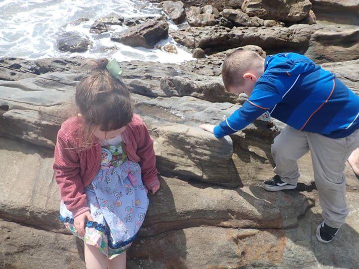 Kids playing on the rocks on Laguna Beach.| 24 Hours in Orange County, CA