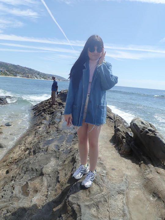 Girl posing on the rocks on Laguna Beach.| 24 Hours in Orange County, CA