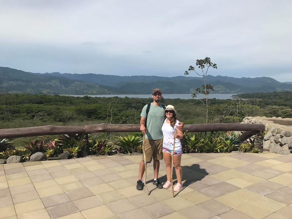 Couple posing in front of the lake at the Lava Fields Walk and Ecotermales Hot Springs in Costa Rica.   Costa Rica, Arenal Volcano
