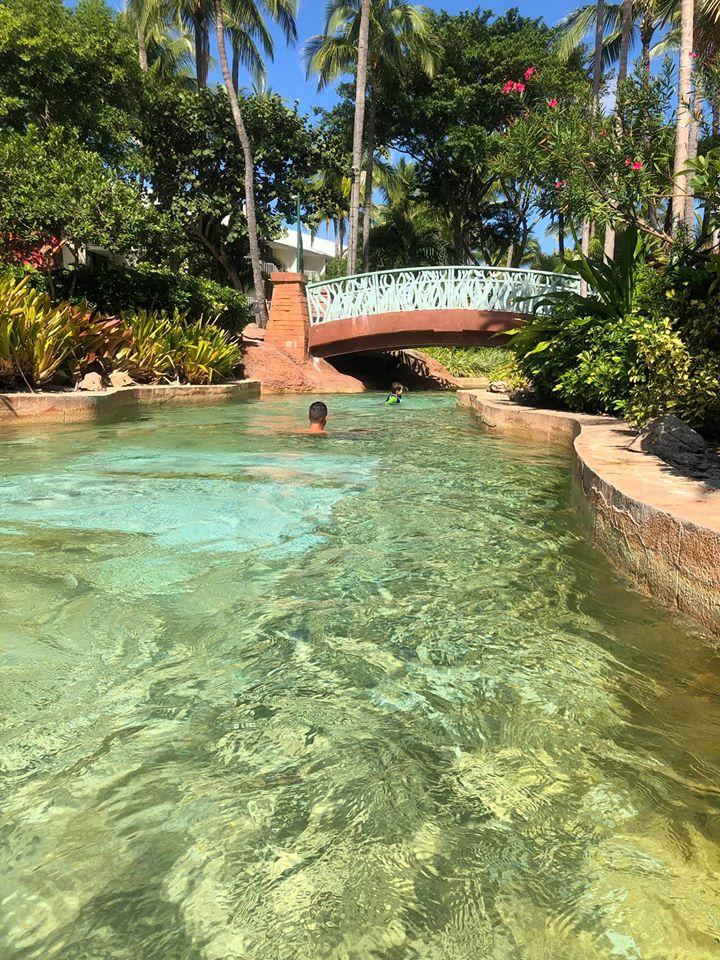People swimming in the Lazy River at the Atlantis resort.   Atlantis, Bahamas
